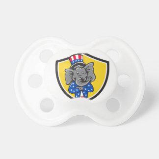 共和党象のマスコットの腕によって交差させる盾車 おしゃぶり