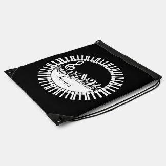 円のピアノ鍵および乱雑な音楽ノート ナップサック
