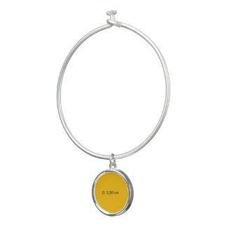 円形の単チャームの黄色の腕輪のブレスレット バングルブレスレット