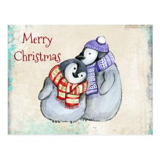 冬のスカーフおよび帽子のクリスマスのかわいいペンギン ポストカード