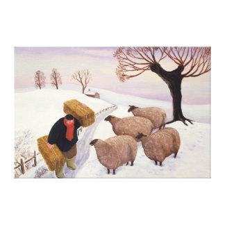 冬のヒツジへの干し草を運ぶこと キャンバスプリント