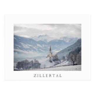 冬の白い文字の郵便はがきのZillertalの教会 ポストカード
