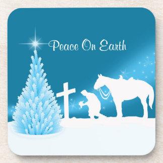 冬の雪場面を祈っている西部のクリスマスのカウボーイ コースター