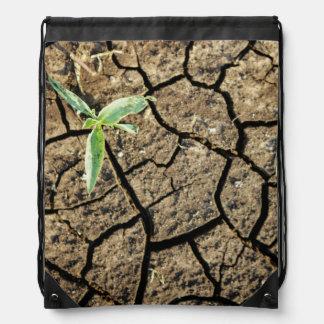 割れた地球の実生植物 ナップサック
