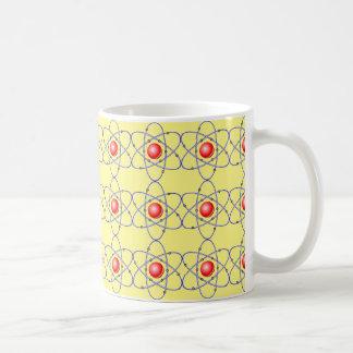 化学、核心。 大きい強打。 黄色い背景 コーヒーマグカップ