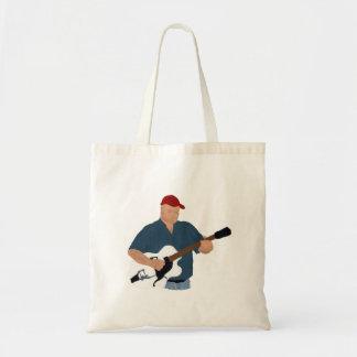 半空の赤い帽子の青いSH絵を描いているギター奏者 トートバッグ