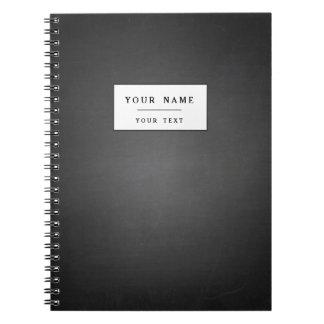印刷される素朴で黒い黒板 ノートブック