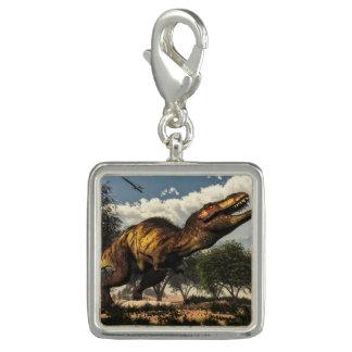 卵を保護しているティラノサウルス・レックスのレックスの恐竜 チャーム
