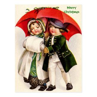 古いクリスマスのイメージのビクトリアンな子供及び傘 はがき