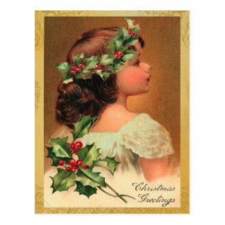 古いファッションのヒイラギの女の子のクリスマスの休日 葉書き