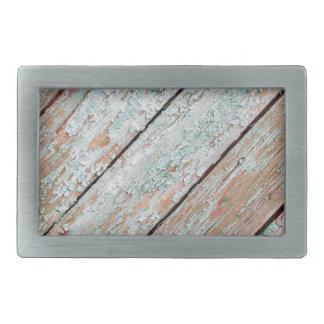 古い木の板の表面の片 長方形ベルトバックル