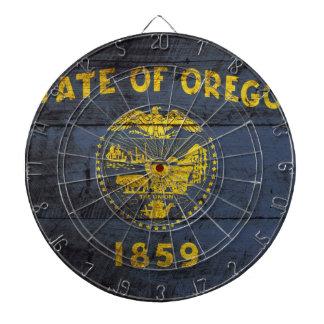 古い木製の穀物のオレゴンの州の旗 ダーツボード