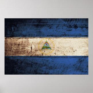 古い木製の穀物のニカラグアの旗 ポスター