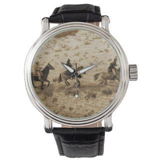 古い西のカウボーイの乗車 腕時計