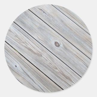 古く擦り切れたな木製のデッキのクローズアップの写真 ラウンドシール