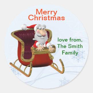 名前入りなクリスマスのサンタのギフトのラベルかラベル ラウンドシール