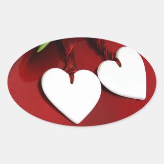 咲くロマンスのロマンチックな花のハート 楕円形シール