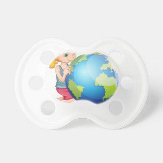 地球を見ている小さな女の子 おしゃぶり