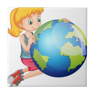 地球を見ている小さな女の子 タイル