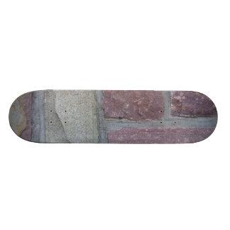 壁のスケートボードの煉瓦 スケボーデッキ