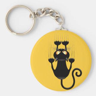 壁のkeychainを傷付けるおもしろいな黒猫の漫画 キーホルダー