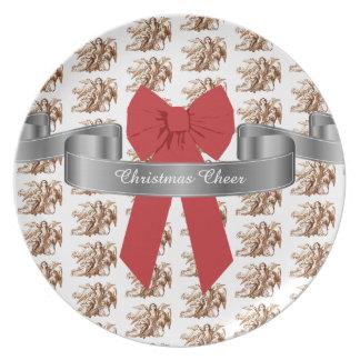大きく赤い弓および天使のクリスマスの応援 プレート