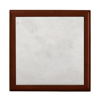 大理石のクリーム色の背景灰色プラスター質 ギフトボックス