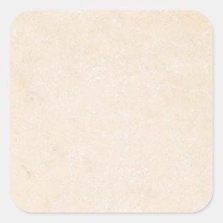 大理石の石造りのクリーム色の中立タイルの背景のブランク 正方形シールステッカー
