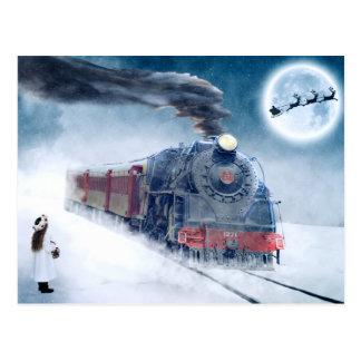 女の子およびサンタが付いている真夜中のクリスマスの列車 ポストカード