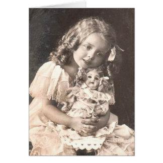 女の子および彼女の人形のヴィンテージの旧式なポートレート カード