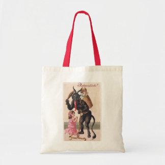 女の子のヴィンテージの鬼のクリスマスをおびえさせるKrampus トートバッグ