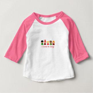 """女の赤ちゃんのRaglanのTシャツ""""私が""""イメージを歌うことを愛する ベビーTシャツ"""