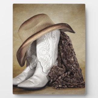 女性のカーボーイのブーツの西部のレースの帽子 フォトプラーク
