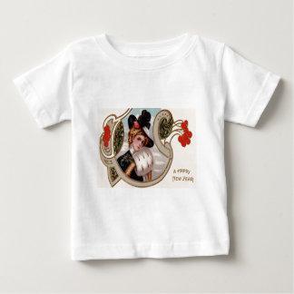 女性の冬のヒイラギのばら色のヤドリギ ベビーTシャツ