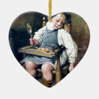 子ネコの旧式な絵画に食糧を与えている子供 セラミックオーナメント