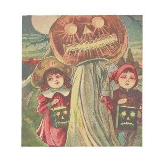 子供の幽霊のジャックOのランタンのカボチャ ノートパッド