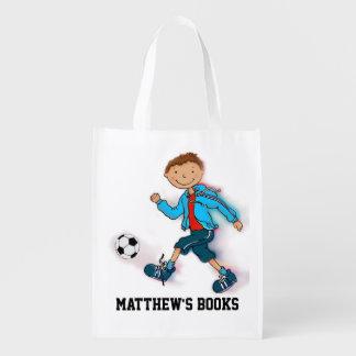 子供はSoccerの男の子の図書館のブックバッグを示しました エコバッグ