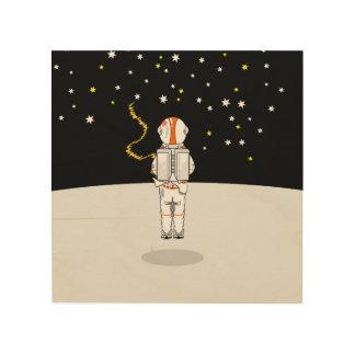 宇宙の宇宙飛行士によってつかまえられる短いWeeing ウッドウォールアート