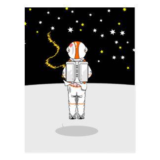 宇宙の宇宙飛行士によってつかまえられる短いWeeing ポストカード