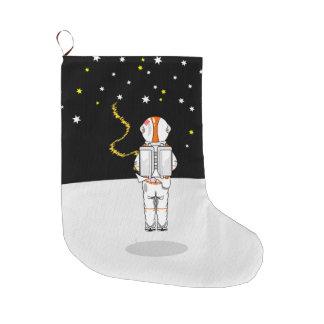 宇宙の宇宙飛行士によってつかまえられる短いWeeing ラージクリスマスストッキング