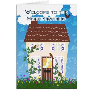 家および花が付いている近隣への歓迎 グリーティングカード