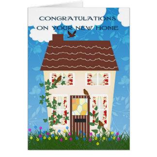 家および花との新しい家のお祝い グリーティングカード