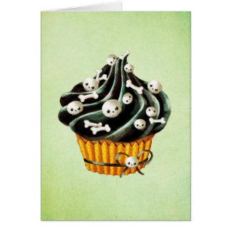 小さいスカルを搭載するハロウィンの黒いカップケーキ カード