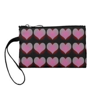 小さいピンクのハートの化粧品のバッグおよびリストレット コインパース