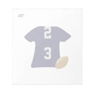 小さいメモ帳の球が付いているあなたのフットボールのワイシャツ ノートパッド