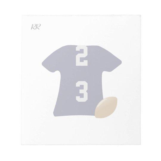 小さいメモ帳の球が付いているあなたのフットボールのワイシャツ メモパッド
