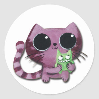 小さい緑モンスターを持つかわいい子猫猫 ラウンドシール