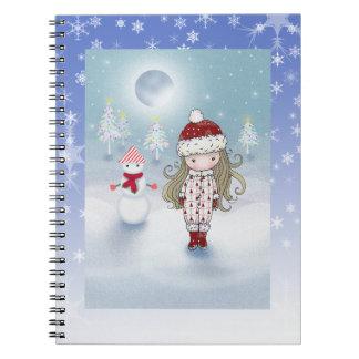 小さな女の子および雪だるまの休日のノート ノートブック
