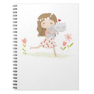 小さな女の子は彼女の子猫猫のノートを愛します ノートブック
