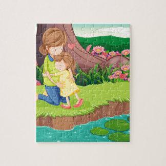 川岸で彼女の娘を抱き締めている母 ジグソーパズル